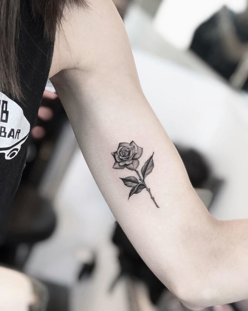 The idea of this rose tattoo looks very simple but very beautiful and very personal.